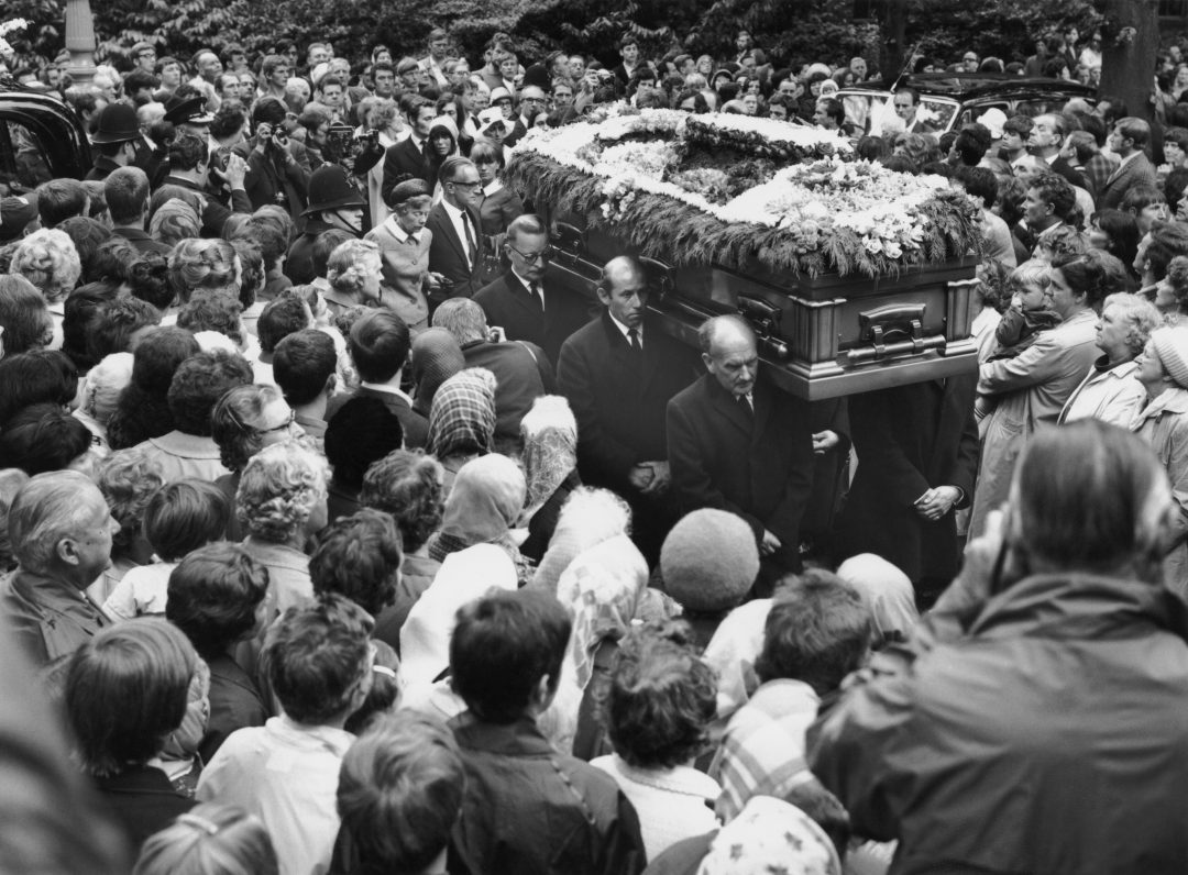 Crowds surround the coffin of Rolling Stones guitarist Brian Jones (1942 - 1969) at his funeral in Cheltenham, Gloucestershire, 10th July 1969